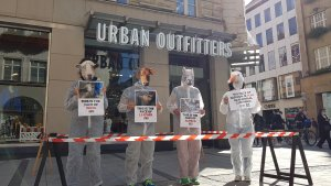Protestors dressed as animals stand outside of Urban Outfitters in Munich, Germany