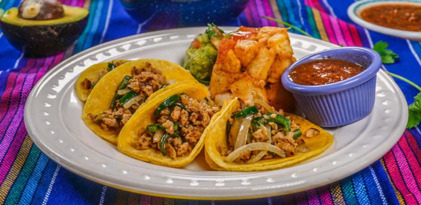 tacos on a plate with sauce