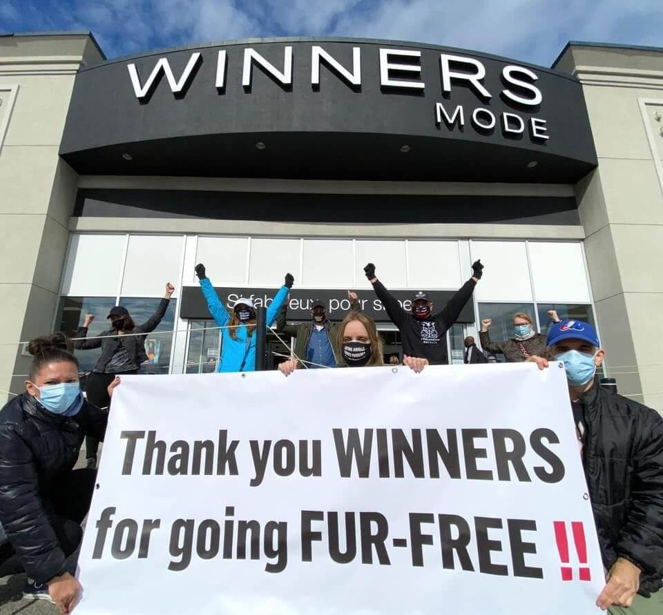 local activists hold demo with sign thanking Winners for going fur free