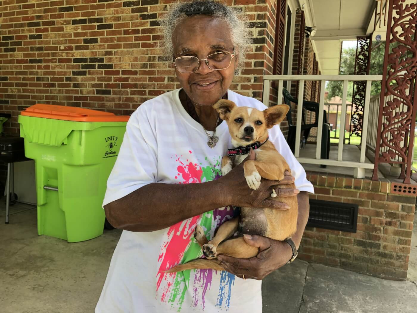 Penny and her owner after she was transported to and from a spay and neuter clinic free of charge.