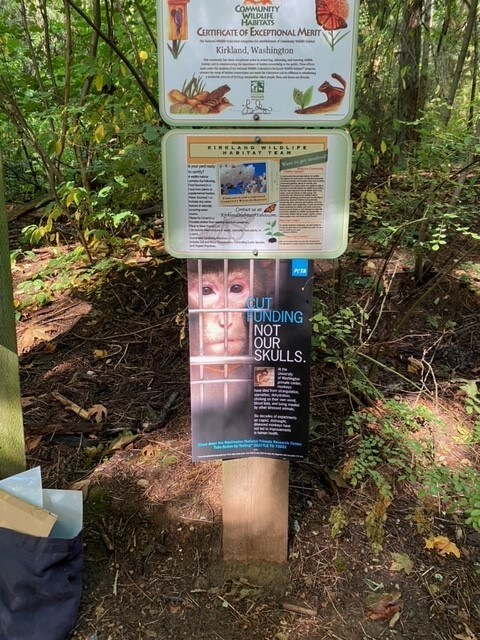 Poster calling for an end to funding for uw primate center