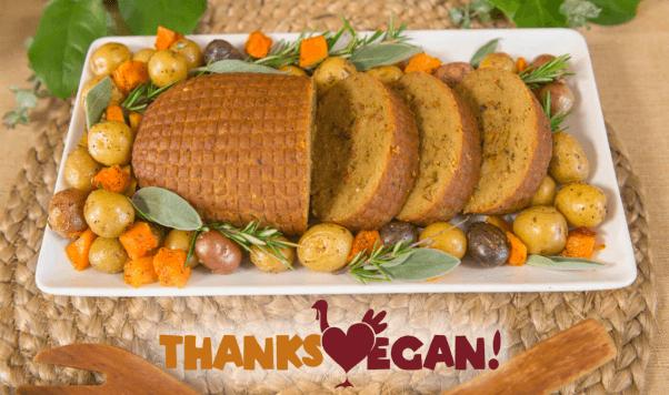 Thanksvegan logo with vegan roast and potatoes on a plate