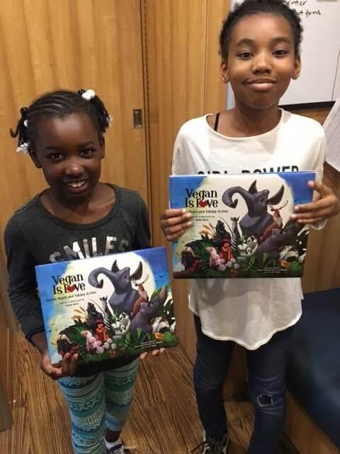 Kids Holding Books from PETA's Barks to Books Program