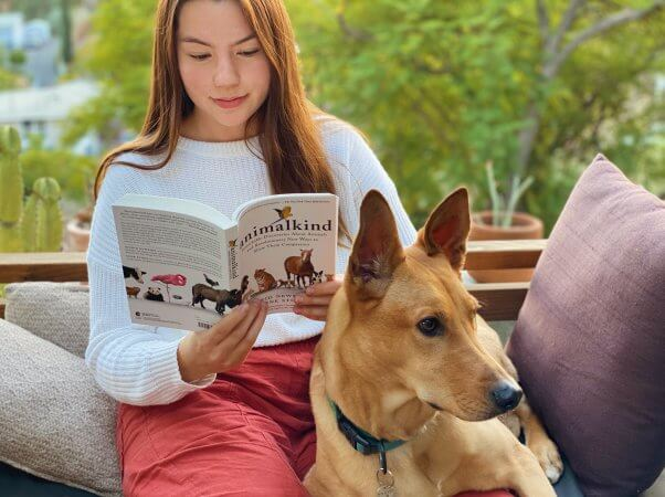 Animalkind reader and dog on couch