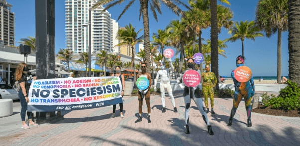 Bodypainted 'Animals' Lead Rally Against Injustice