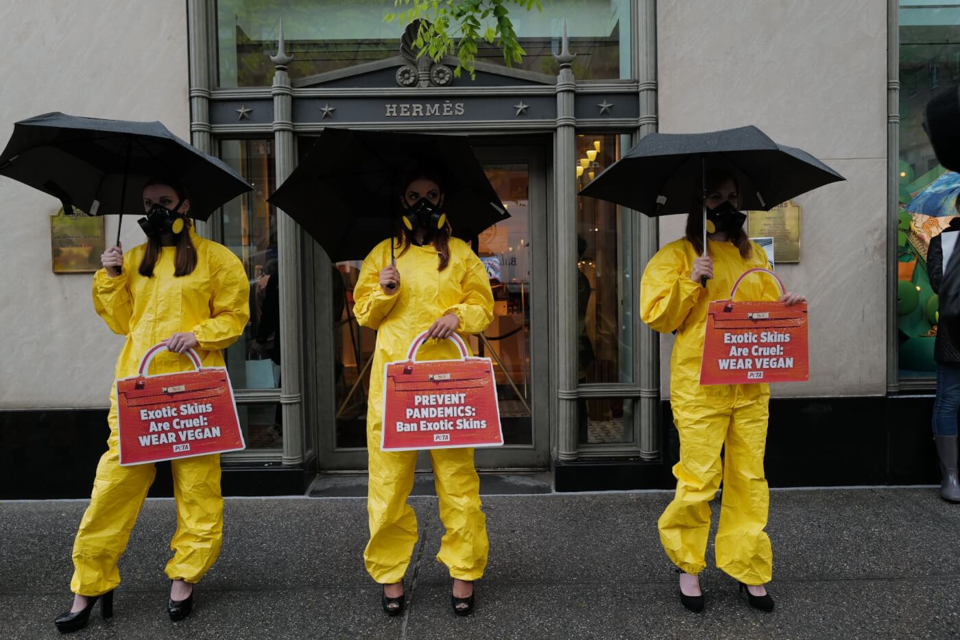 Hazmat suits and high heels PETA protest outside Hermes NYC