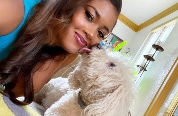 AJ Ross and her canine companion, Kobe; Kobe died during a nail trim, and four PetSmart employees were later charged