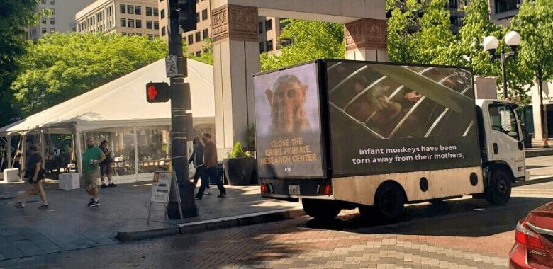 Mobile Billboard Urges Closure of Cruel Primate Laboratory