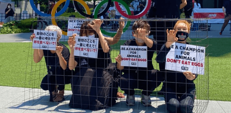 Caged PETA Asia Members Protest Olympic Egg Cruelty