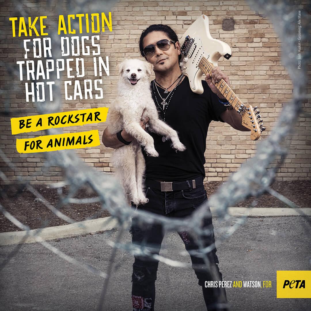 Chris Perez poses with dog, Watson, for PETA